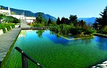Natural swimming pool of the Hotel Marini in Dorf Tirol with a view to the surrounding mountains at Merano.