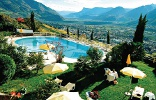 Garden and pool of the hotel Rimmele with a great view over the surrounding mountains of Dorf Tirol.